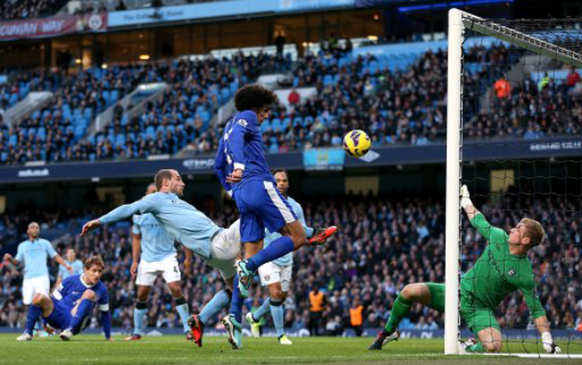 Everton's Marouane Fellaini scores his side's first goal of the game
